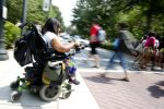 UNCG student Ricole Wicks crosses Spring Garden Street as she makes her way to her next class. One of the reasons sophomore Ricole Wicks chose UNCG was the university's dedication and responsiveness to accessibility issues for today's disabled students.