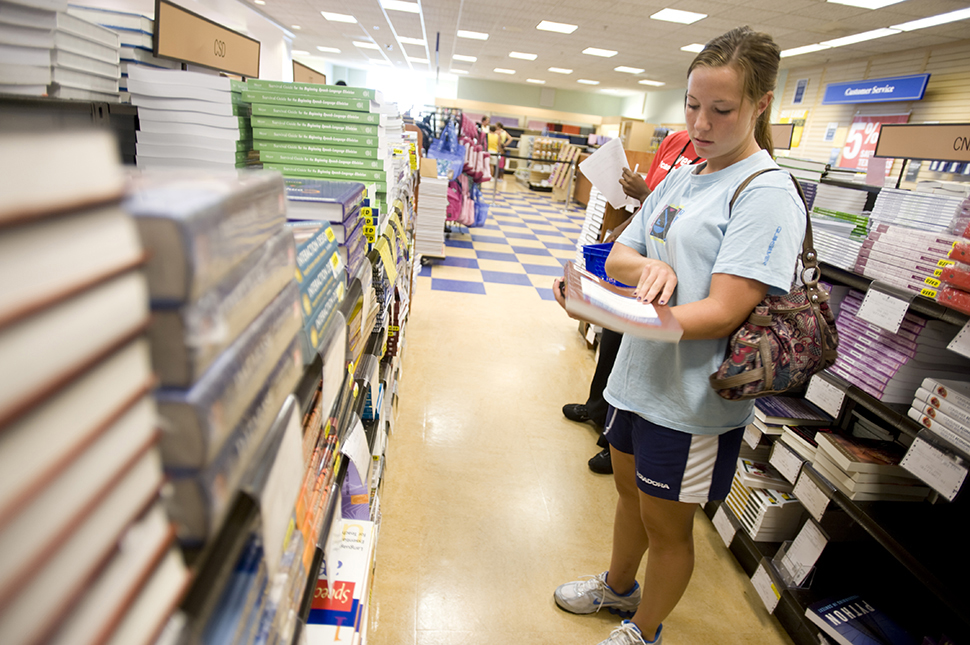 UNCG Sophomore and student athlete, looks over prices of books at the UNCG Bookstore.
