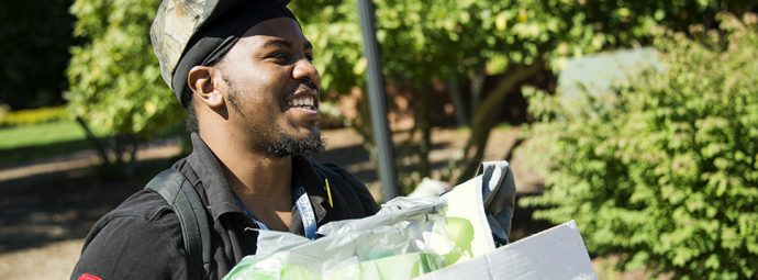 UNCG student Montero Carter smiles as he works to move into his dorm at UNCG. (David Wilson/UNCG photo)