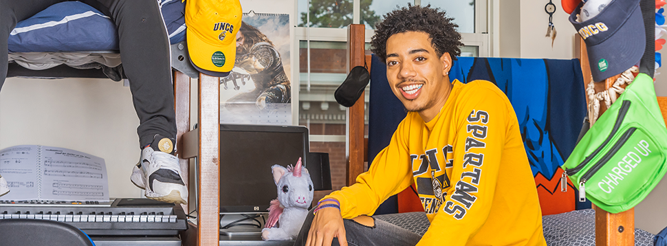 A student in his room in Shaw Residence Hall