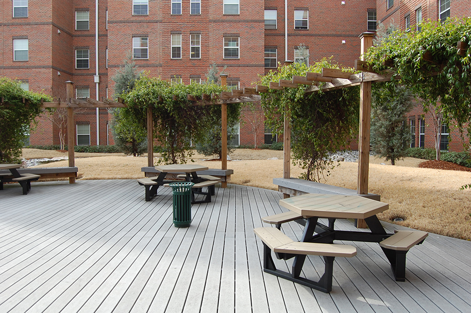 outside seating and deck at the back of spring garden apartments - Spring Garden Apartments